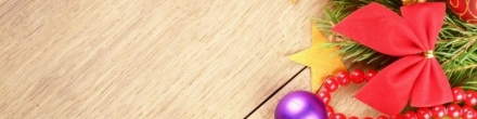 colorful-christmas-decorations-on-wooden-background-banner-800x200