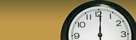 wall-clock-on-golden-background-header