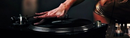 girl-dj-with-music-turntable-and-mixer-web-header