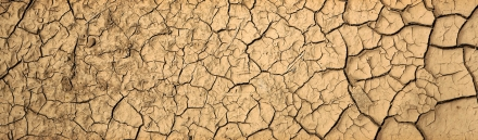 dry-cracked-desert-yellow-sand-close-up-background-header