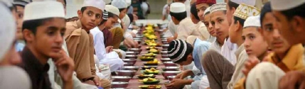 muslims-wait-for-taking-iftar-at-a-mosque-web-header