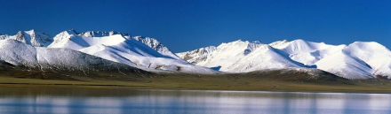 amazing-iceland-blue-lagoon-and-snow-mountains-header_size-1024x300