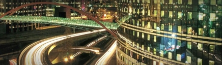 business-district-buildings-night-scene-web-header_size-1024x300
