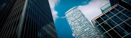 corporate-buildings-and-clouds-blue-web-header_size-1024x300